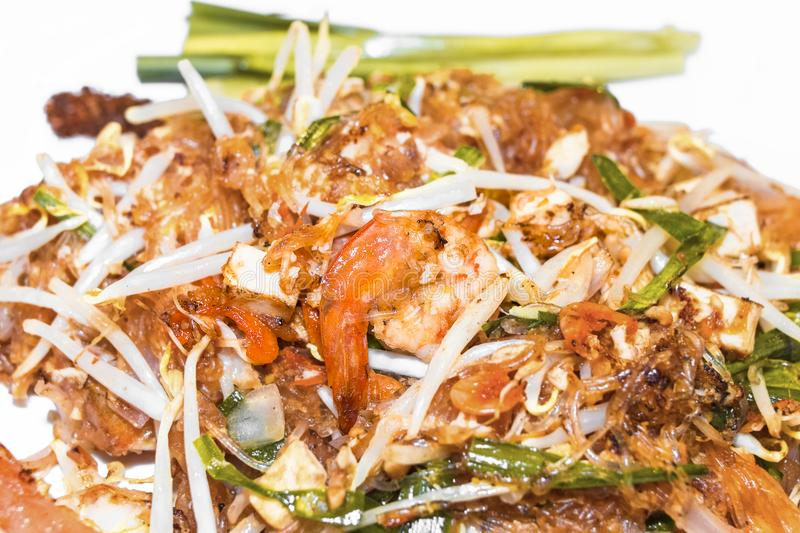 Pad Thai Goong Sod Fried Rice Sticks with Shrimp.Thai food. Closed up.Copy space on white background royalty free stock photo
