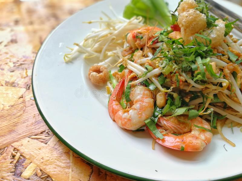 Pad Thai Goong Sod. Fried Rice Sticks with Shrimp on white plate with chopsticks stock image