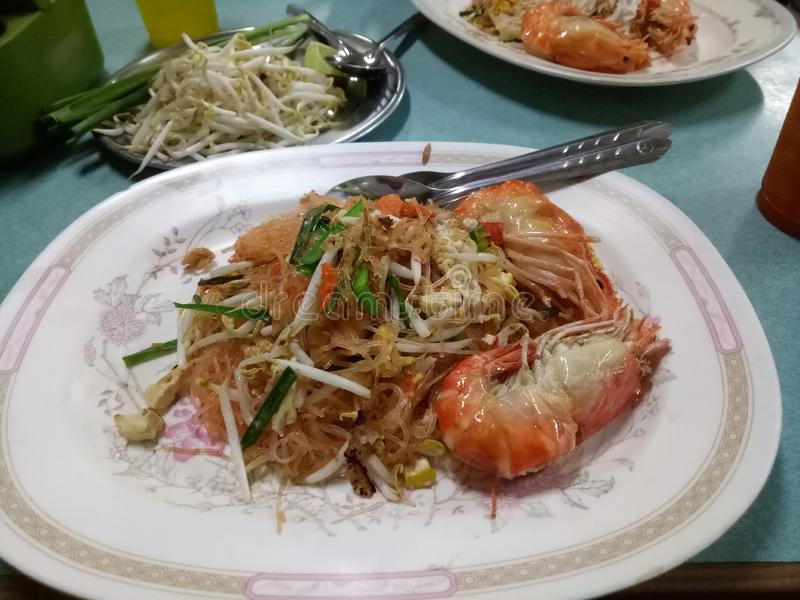 Pad Thai Goong Sod name food Fried Rice Sticks with Shrimp Add bean sprouts and stir the eggs and stir, then serve on a plate. Closeup Pad Thai Goong Sod name stock photography