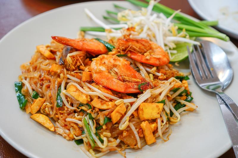Pad Thai Goong Sod on a white plate. Pad Thai Goong Sod,Fried Rice Sticks with Shrimp on a white plate stock photography