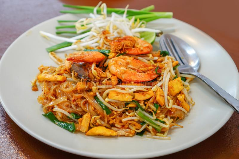 Pad Thai Goong Sod on a white plate. Pad Thai Goong Sod,Fried Rice Sticks with Shrimp on a white plate stock image