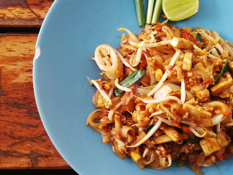 Pad thai noodles close-up on the table. Top view Thailand royalty free stock image