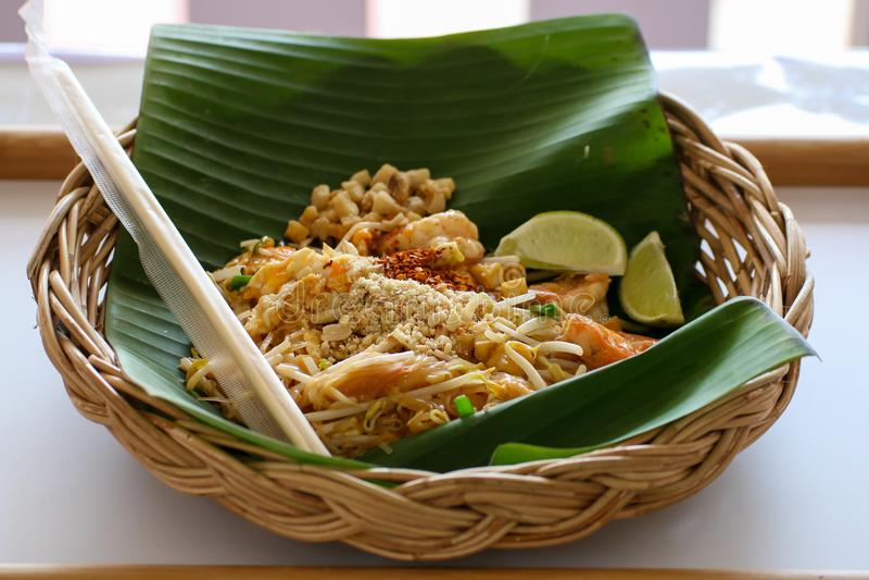 Pad Thai Noodles Thai Food. Pad Thai noodles. Thai Fried Noodle With Shrimp, bean, cayenne pepper and Lemon on Banana leaf stock image