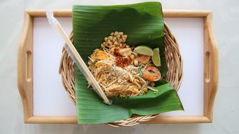 Pad Thai Noodles Thai Food. Pad Thai noodles. Thai Fried Noodle With Shrimp, bean, cayenne pepper and Lemon on Banana leaf stock photo