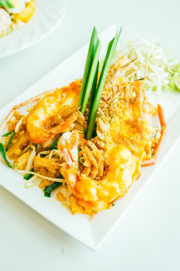 Pad thai noodles. With prawn or shrimp in white plate stock image