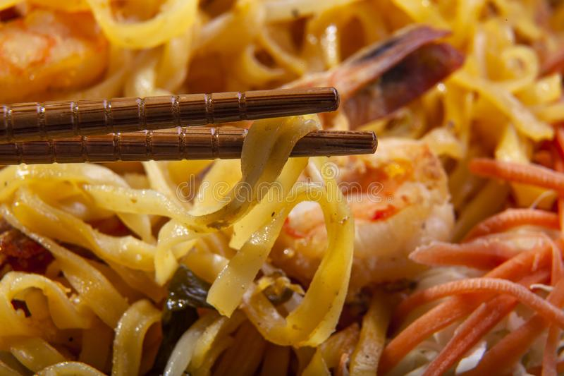 Pad Thai Noodles on a Plate with Chopsticks. Delicious stir fried noodles called pad thai in thailand is a tasty dish. It is made with seafood such as shrimp or stock image