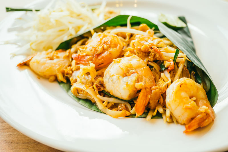 Pad thai noodles. With prawn in white plate - Color Filter Processing stock photography
