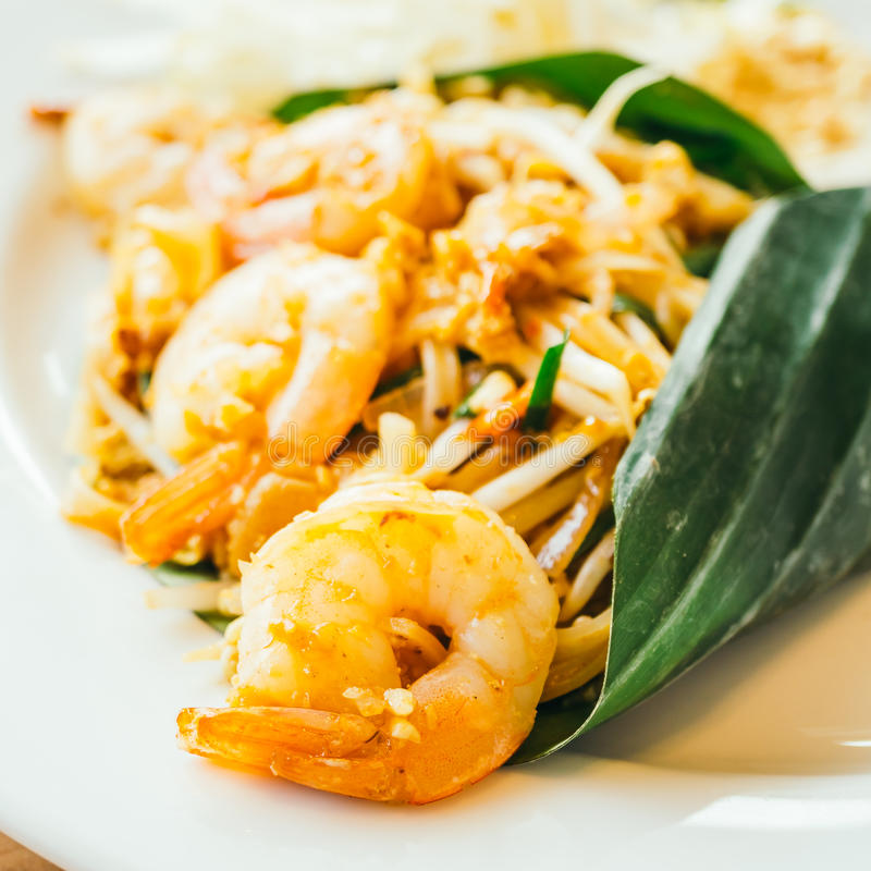 Pad thai noodles. With prawn in white plate - Color Filter Processing royalty free stock image