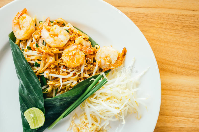 Pad thai noodles. With prawn in white plate - Color Filter Processing stock image