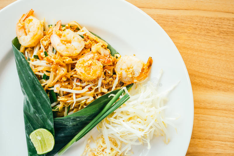 Pad thai noodles. With prawn in white plate - Color Filter Processing stock images