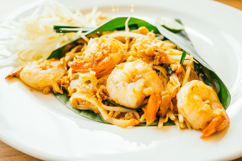 Pad thai noodles. With prawn in white plate - Color Filter Processing stock photos