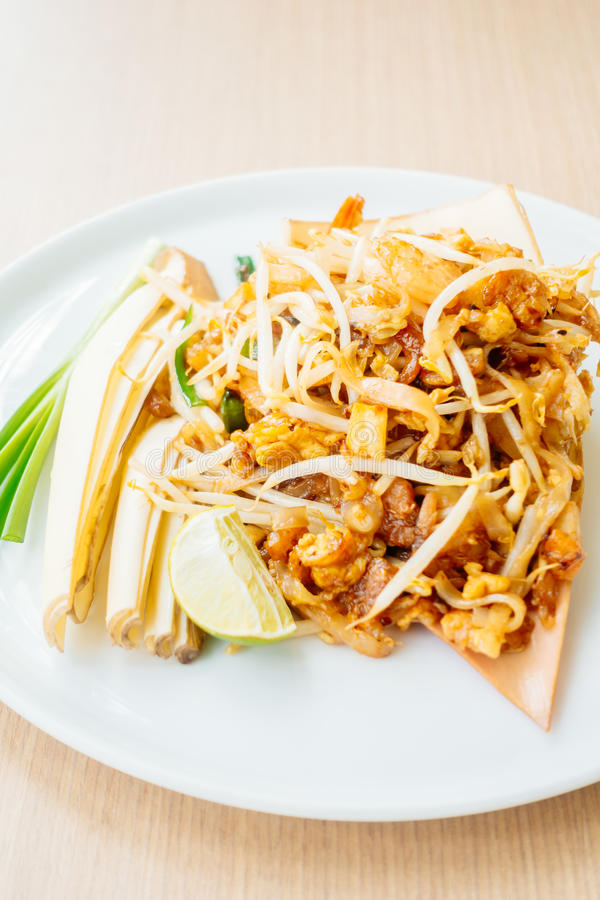 Pad thai noodles. With shrimp and prawn in white plate - Vintage light Filter royalty free stock image