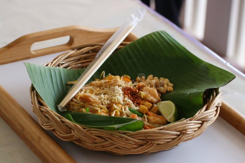 Pad Thai Noodles Thai Food. Pad Thai noodles. Thai Fried Noodle With Shrimp, bean, cayenne pepper and Lemon on Banana leaf stock photos