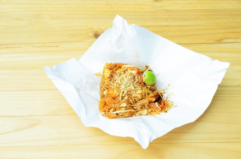 Pad thai in paper package for take away for Thai noodle food. Backgrounds stock photo