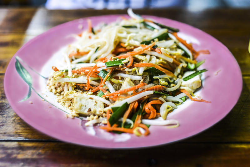 Pad thai on pink on a plate in restaurant, Thailand.  stock images