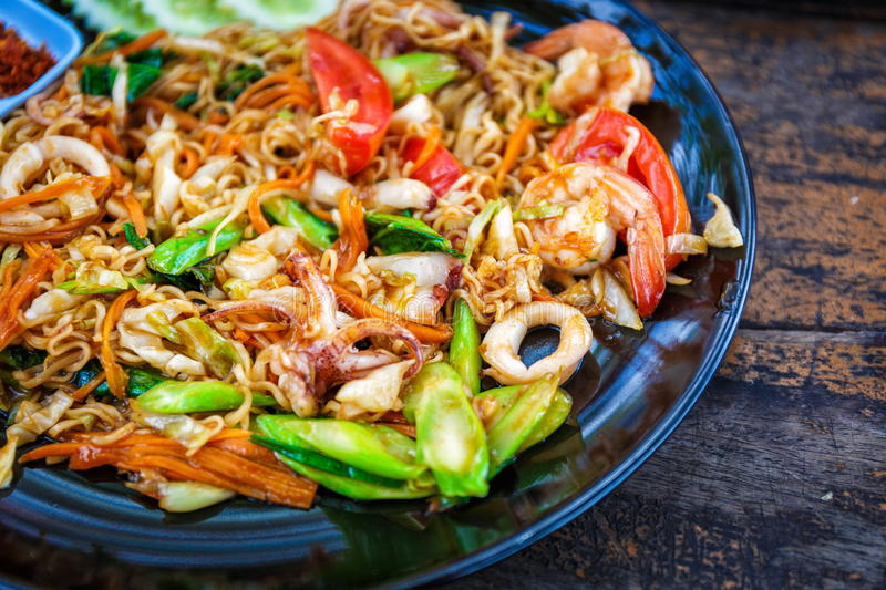 Pad thai with shrimps. Seafood pad Thai dish with shrimp in Thailand royalty free stock photos