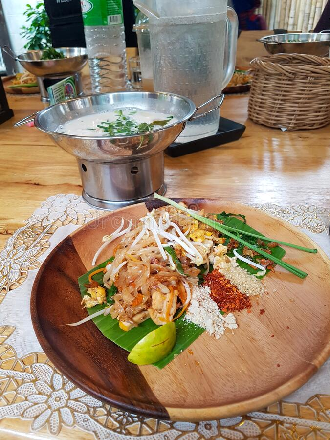 Pad thai soup ingridients fried noodles stier lime pepper chilli spouse cooker wood plate chiang mai thai food cooking. Thailand royalty free stock image