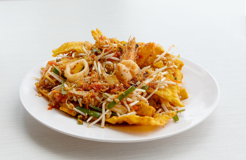 Pad thai stir fried noodles of thailand on white dish. A pad thai stir fried noodles of thailand on white dish stock images