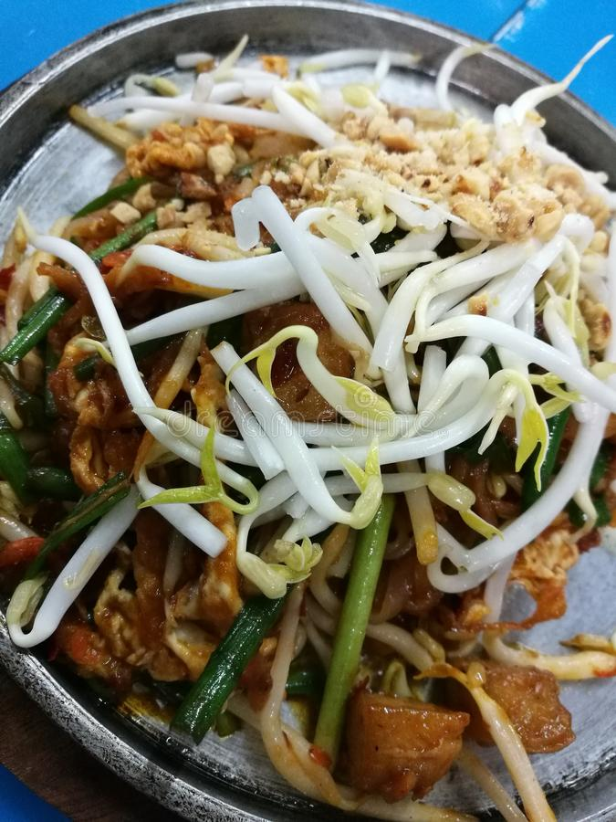 Pad Thai. Stir-fried rice noodle dish commonly served as a street food and at casual local eateries in Thailand royalty free stock photo