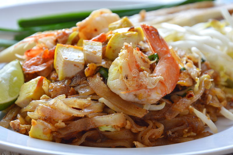 Pad Thai stir fried rice noodle with shrimp and egg on dish stock photo