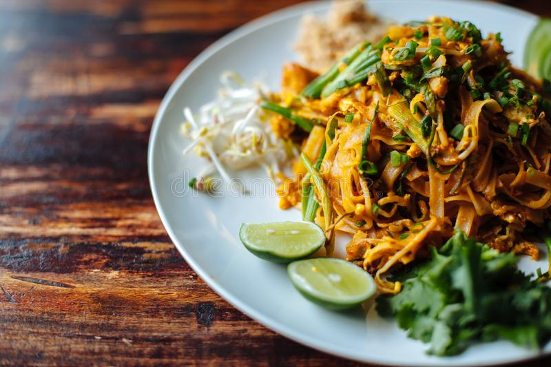 Close up Padthai noodle with smoke tofu and mixed vegetable - wheat germs,lime,cucumber,parsley.Healthy Vegetarian vegan stock image