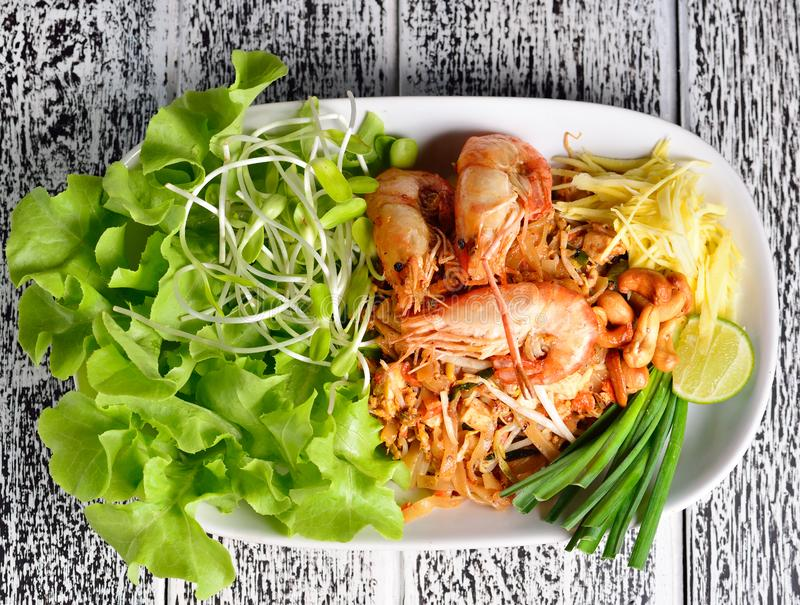 Pad thai, Thai cuisine on a wooden table.  royalty free stock photography