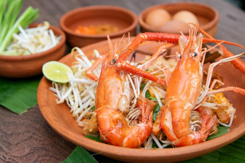 Pad Thai or Thai Style Stir-fried Noodle. Topped with Whole Prawn royalty free stock images