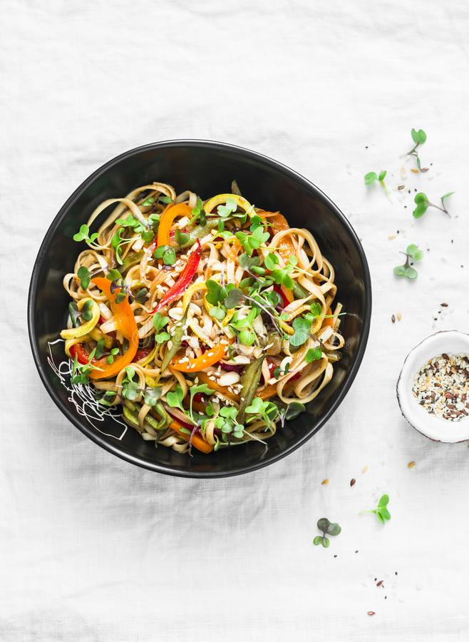 Pad Thai vegetarian vegetables udon noodles in a light background, top view. Vegetarian food. In asian style royalty free stock image