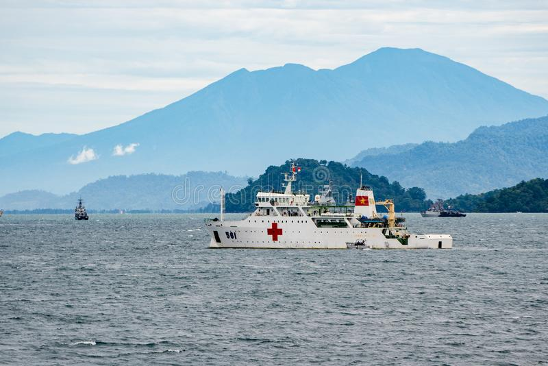 Vietnam People`s Navy Hospital Ship Khanh Hoa HQ-561 anchors in the sea. PADANG, INDONESIA - APRIL 11, 2016 : Vietnam People`s Navy Hospital Ship Khanh Hoa HQ royalty free stock photos