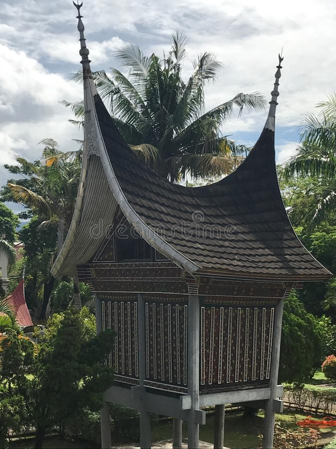 Padang Indonesia Minangkabau Architecture. On the island of Sumatra in Indonesia, traditional Minangkabau architecture with spires and intricate details located stock photography