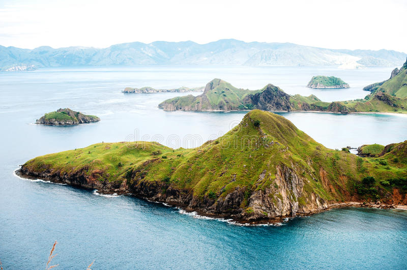 Padar Island, Komodo National Park in East Nusa Tenggara, Indonesia. Amazing marine seascape with mountains and rocks royalty free stock image