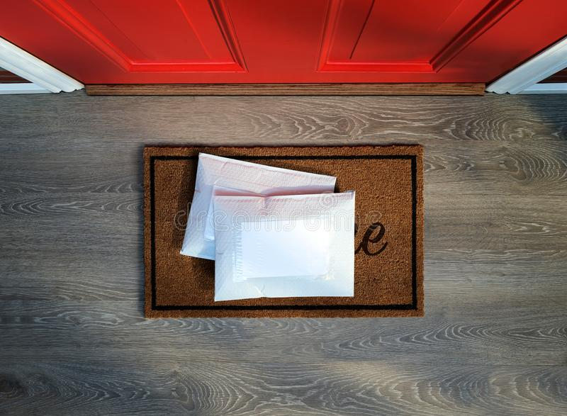Padded envelopes delivered to front door. Padded envelopes delivered to door step. Overhead view. Add your own copy stock image