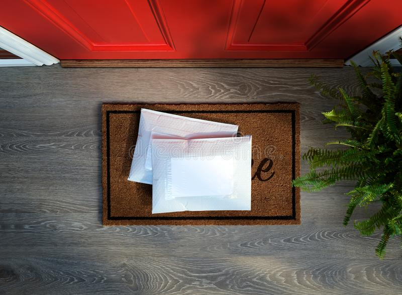 Padded envelopes delivered outside front door. Two padded envelopes delivered to residential front door step. Overhead view. Add your own copy stock images