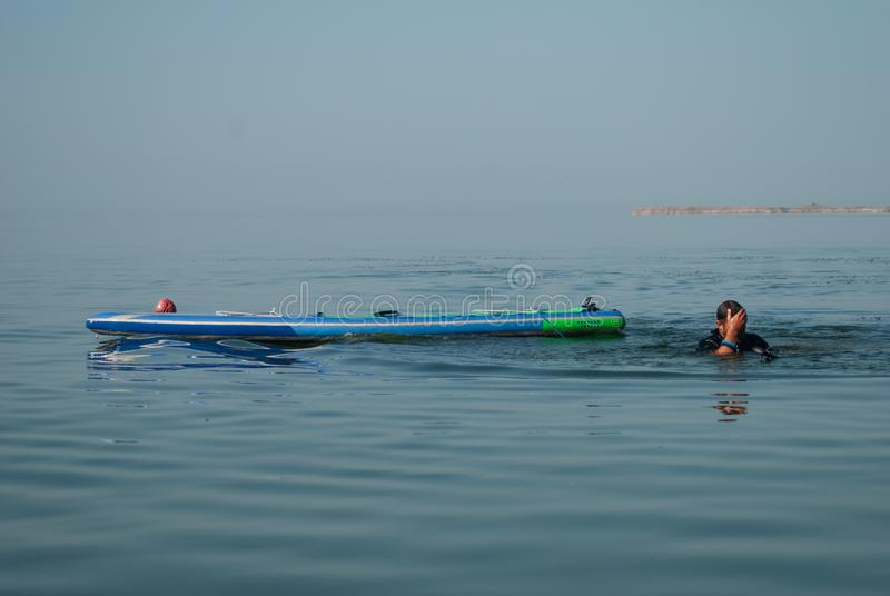 Paddle Board chill out, man overboard, water accident, royalty free stock images