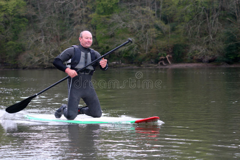 Paddle boarder. On the River dart royalty free stock photos