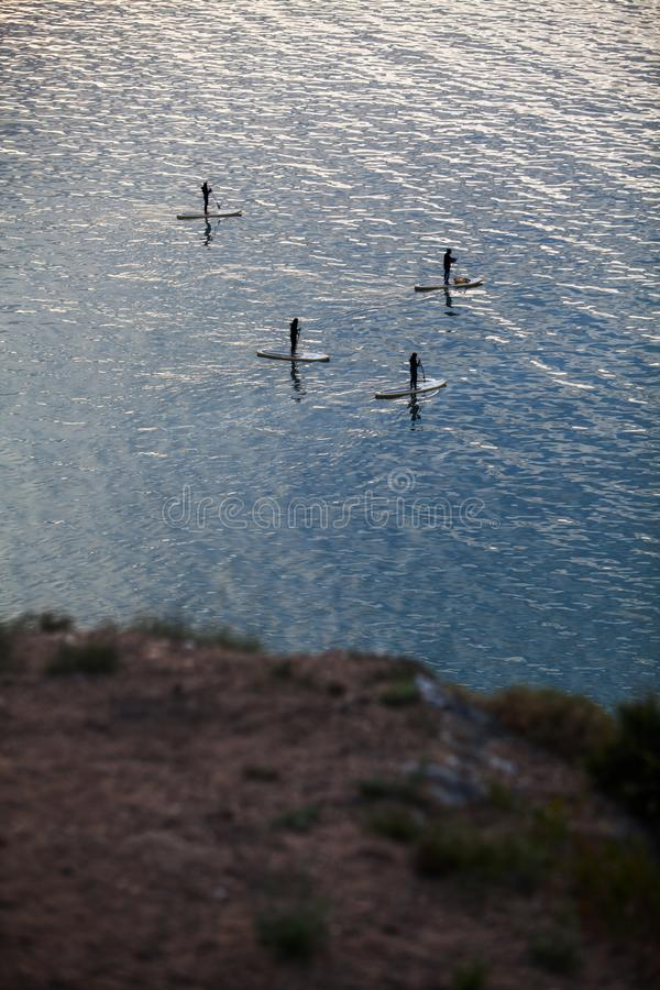 Paddle boarders on lake. High angle shot of a paddle boarders on a lake royalty free stock photography