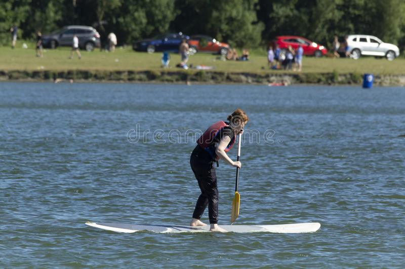 Paddle boarding on a lake stock photography