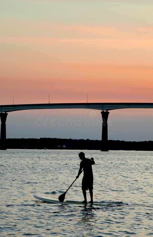 Paddle Boarding at Sunset stock image