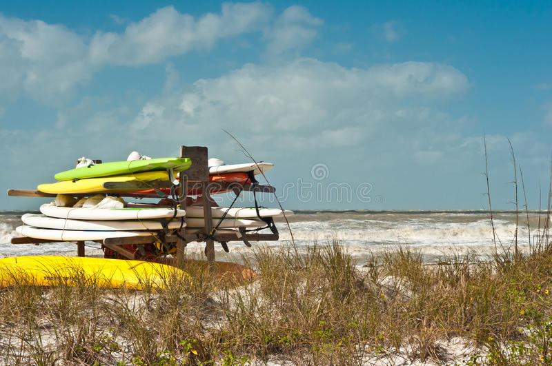 Paddle boards on a wooden rack for storage royalty free stock photography