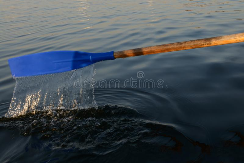 Paddle boat with flowing water. Above the surface of the lake royalty free stock photo