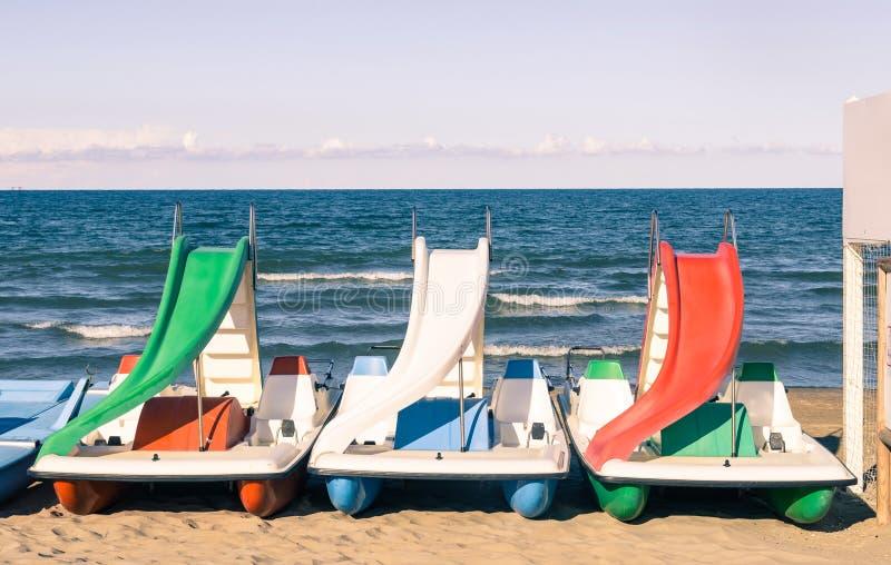 Paddle Boat at italian Beach stock photo