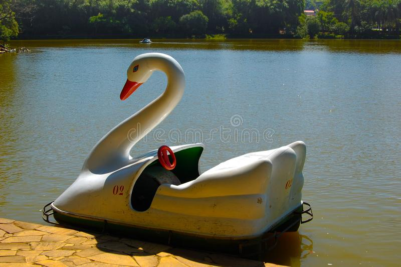 Paddle boat on the lake. Empty paddle boat on the lake. Sunny summer day with lights reflecting on the water. Travel destination with lots of fun and things to stock photo