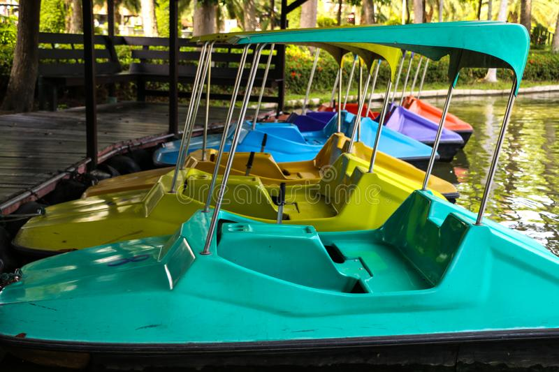 Paddle boat on river. Paddle boat in summer at thailand stock photos