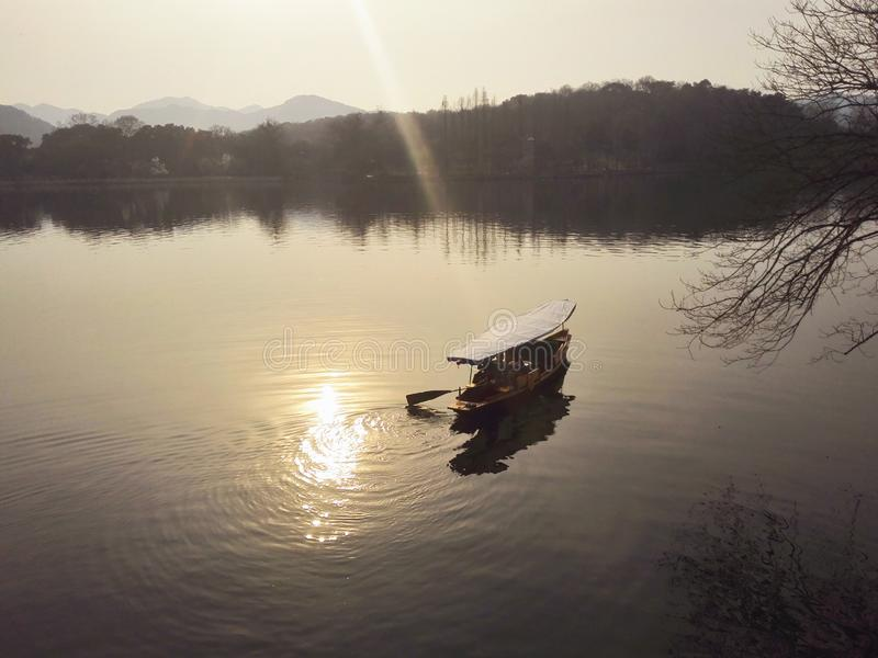 A paddle boat on a lake. A paddle boat on the west lake。hangzhou,China royalty free stock photo
