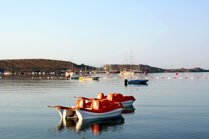 Paddle boats on sea stock photos