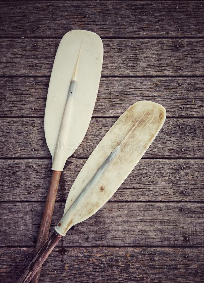 Paddle for canoe or kayak boat. On wooden floor stock images