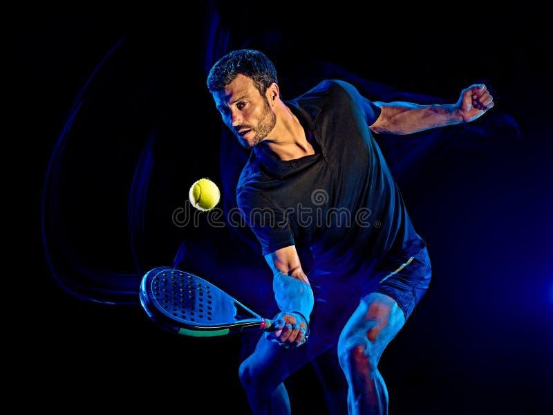 Paddle gracza w tenisa mężczyzny światło maluje czarnego tło obraz royalty free