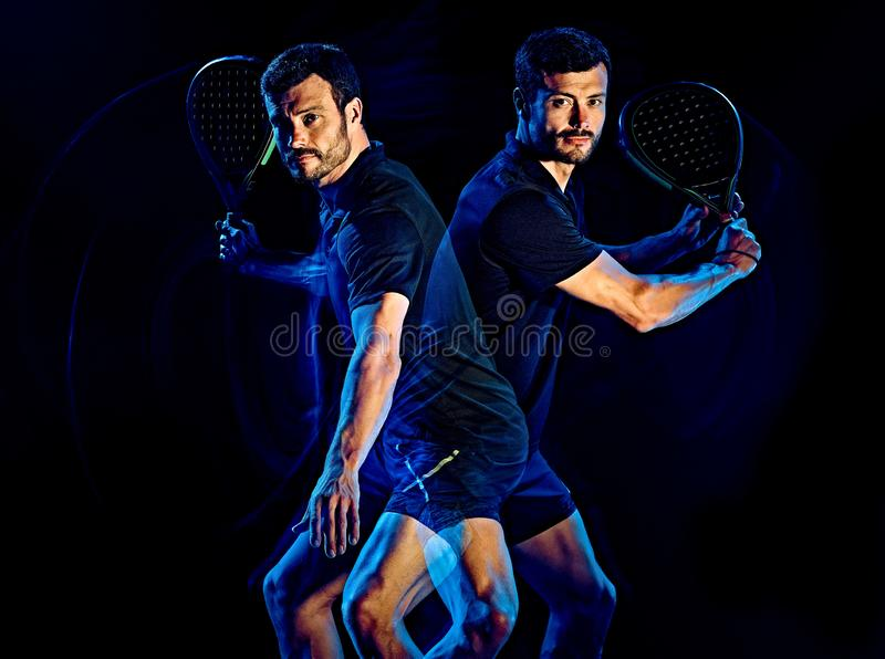 Paddle gracza w tenisa mężczyzny światło maluje czarnego tło obrazy royalty free