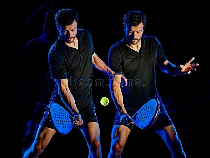 Paddle gracza w tenisa mężczyzny światło maluje czarnego tło fotografia royalty free