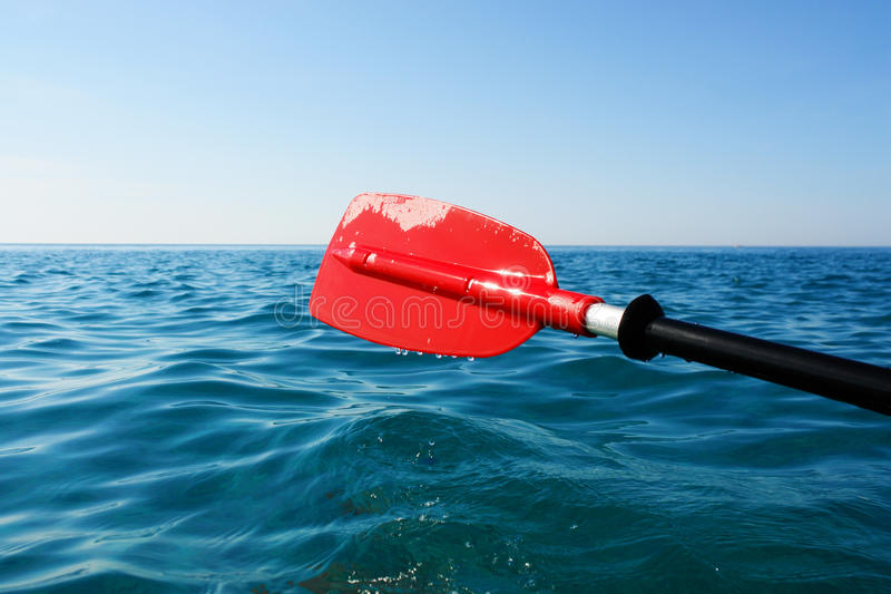 Paddle red in ocean stock photos